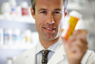 Pharmacist Holding Pill Bottle