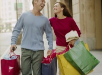 Couple on City Sidewalk with Shopping Bags